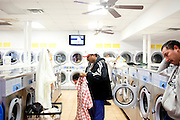 Roberto Barajas sorts laundry at Coin Laundry in East Point, Georgia December 30, 2009. Monica, Roberto's wife, has been separated from her husband and son so she can continue dialysis in Mexico.