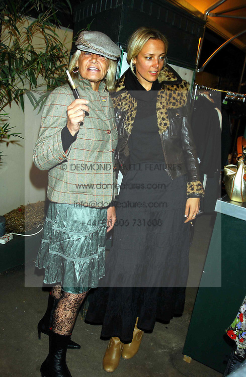 Left to right, Rock Roll figure ANITA PALLENBURG and designer BAY GARNETT at an exclusive evening featuring the greatest talents in fashion today in aid of the African children who have been affected bt the AIDS epidemic held at the Chelsea Gardener, Sydney Street, London on 20th September 2004<br />