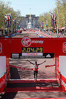 Wilson Kipsang of Kenya crosses the finishing one in a time of 02:04:29 to win the Elite Men's Race of The Virgin Money London Marathon 2014 on13 April 2014.<br /> Photo: Dillon Bryden/Virgin Money London Marathon<br /> media@london-marathon.co.uk