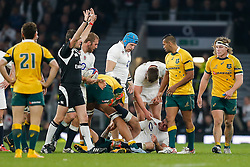 England Outside Centre Brad Barritt goes down with a cut to his eye and holds his calf after taking Australia hit from Australia replacement Quade Cooper - Photo mandatory by-line: Rogan Thomson/JMP - 07966 386802 - 29/11/2014 - SPORT - RUGBY UNION - London, England - Twickenham Stadium - England v Australia - QBE Autumn Internationals.