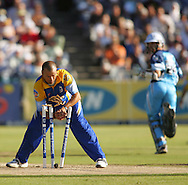 CAPE TOWN, SOUTH AFRICA - 20 April 2008, Charl Langeveldt breaks the wicket but misses the run out during the Standard Bank Pro 20 Semi Final match between The Nashua Cape Cobras and Nashus Titans held at Sahara Park Newlands in Cape Town, South Africa..Photo by www.sportzpics.net