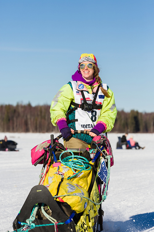 Musher Monica Zappa competing in the 44th Iditarod Trail Sled Dog Race on Long Lake after leaving the restart on Willow Lake in Southcentral Alaska.  Afternoon. Winter.