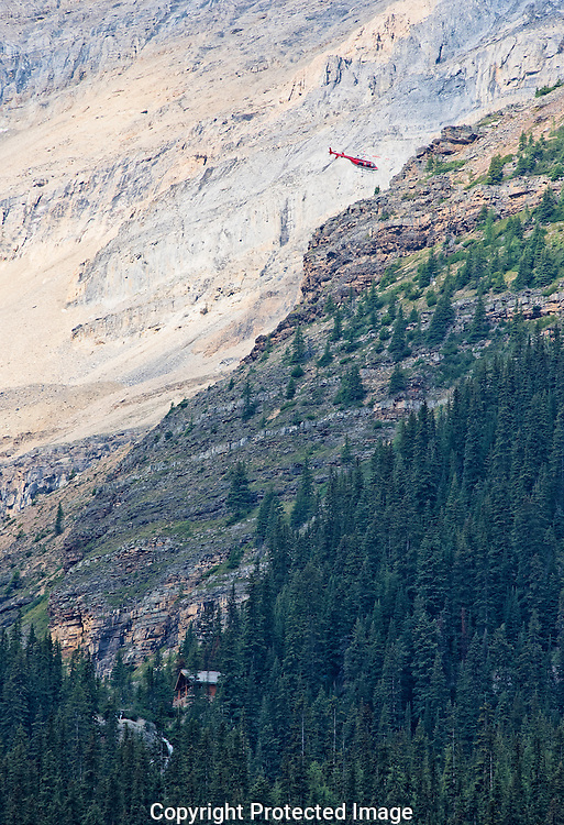 Helicopter delivering to Lake Agnes Tea House., Alberta, Canada, Isobel Springett