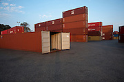 Shipping containers at a port awaiting export