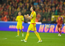 BRUSSELS, BELGIUM - Sunday, November 16, 2014: Wales' Gareth Bale celebrates a point and staying top of the group after the final whistle of a goal-less draw against Belgium during the UEFA Euro 2016 Qualifying Group B game at the King Baudouin [Heysel] Stadium. (Pic by David Rawcliffe/Propaganda)