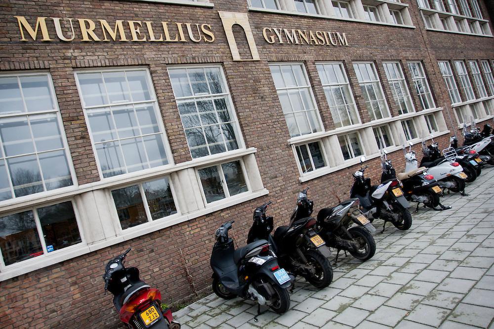 Scooters voor het Murmellius Gymnasium in Alkmaar.<br /> <br /> Scooters parked in front of the Murmellius Gymnasium, a high school, in Alkmaar.