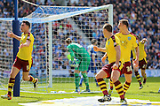 Burnley defender Michael Keane (5) celebrates his equalising goal during the Sky Bet Championship match between Brighton and Hove Albion and Burnley at the American Express Community Stadium, Brighton and Hove, England on 2 April 2016. Photo by Phil Duncan.