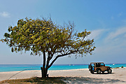 A CAR IS IN ONE BEACH OF GRAND TURK AND CAICOS IN THE CARIBBEAN.