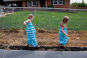 (L-R) Hayley Kudro, 6, and her sister Aubrey, 4, go for a walk in Waynesboro, Virginia on Wednesday, June 15, 2011. Hayley, then 5, was diagnosed with a softball-sized mass near her liver that turned out to be neuroblastoma in September of 2009.