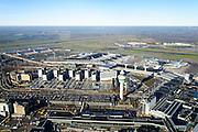 Nederland, Noord-Holland, Haarlemmermeer, 11-12-2013; luchthaven Schiphol. Stationsgebouw en verkeertoren met vluchtleiding omgeven door hotels en diverse kantoorgebouwen geexploiteerd door Schiphol vastgoed (Schiphol Real Estate). Aan de gates geparkeerde vliegtuigen van onder andere KLM.<br /> Schiphol Airport. Terminal building and control tower surrounded by hotels and office buildings operated by Schiphol Real Estate (SRE). At the gates of parked aircraft, amongst others KLM.<br /> luchtfoto (toeslag op standard tarieven);<br /> aerial photo (additional fee required);<br /> copyright foto/photo Siebe Swart