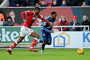 Birmingham City midfielder Jacques Maghoma gets away from Bristol City defender Mark Little during the Sky Bet Championship match between Bristol City and Birmingham City at Ashton Gate, Bristol, England on 30 January 2016. Photo by Alan Franklin.
