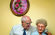 Arthur Garrison, left, puts his arm around his wife Velva while the couple sit for a portrait in their Longmont apartment, October 22, 2007.  The Garrisons have been married since 1937. (Daily Times-Call, Bradley Wakoff)