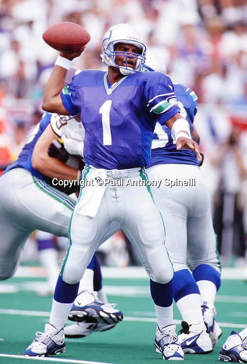 Minnesota Vikings quarterback Warren Moon (1) throws a pass during the NFL Pro Football Hall of Fame football game against the Seattle Seahawks on July 26, 1997 in Canton, Ohio. The Vikings won the game 28-26. (©Paul Anthony Spinelli)
