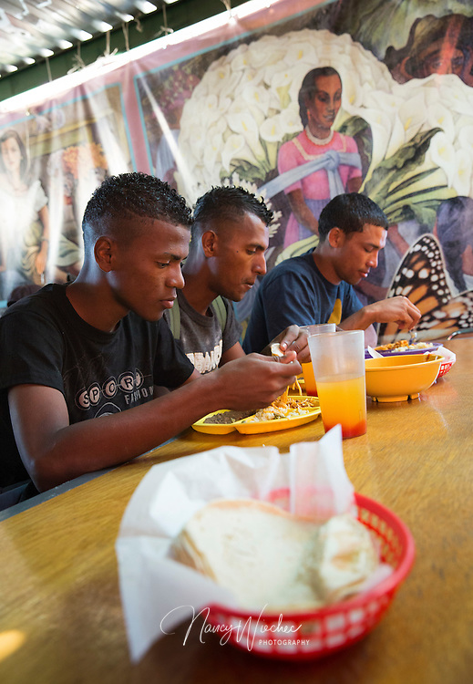 Young men sit down to dinner at the Aid Center for Deported Migrants in Nogales, Sonora, March 31. The center, located just over the U.S. border, is operated by the Jesuit-run Kino Border Initiative. It was one stop a group of U.S. bishops made during a two-day tour of the border area. (CNS photo/Nancy Wiechec) (April 1, 2014)