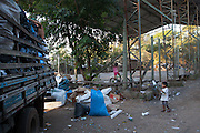Young children play and watch the workers sorting through the huge piles of rubbish at the recycling centre just outside Porte Alegre, Brazil. <br /> <br /> Cirandar is working in partnership with  C&A and C&A Instituto to implement a network of Community Libraries in eight communities of Porto Alegre.