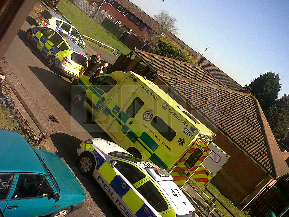 © Licensed to London News Pictures.  28/03/2012. AYLESBURY, UK. *** COLLECT PICTURE ***. Police and ambulance outside a bungalow in the Walton Court area of Aylesbury, Buckinghamshire. Gunshots were reported at 10am this morning. A man was found inside and  taken to hospital with life threatening injuries. Unconfirmed reports suggest that the man was in a wheelchair and recovering from an earlier shooting incident. Photo credit :  Cliff Hide/LNP