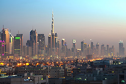 view across old Al Satwa district towards modern skyline of Dubai with skyscrapers in United Arab Emirates