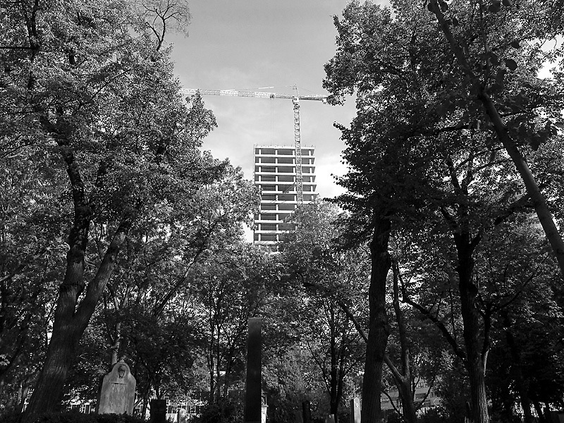 A construction site viewed from one of the cities oldest graveyards from Neighborhoods series