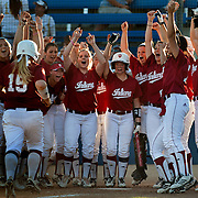 3/1/13 7:49:00 PM --- SOFTBALL SPORTS SHOOTER ACADEMY 010 ---The Indiana State team celebrates as #15 crosses the plate after her solo home run. Indiana State lost 8-2 against California State Fullerton in Fullerton, Calif. on Friday, March 1, 2013. Photo by Michael Pronzato, Sports Shooter Academy