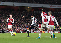 Football - 2017 / 2018 Premier League - Arsenal vs. Newcastle United<br /> <br /> Jacob Murphy (Newcastle United)  with a rare shot at the Arsenal goal at The Emirates.<br /> <br /> COLORSPORT/DANIEL BEARHAM