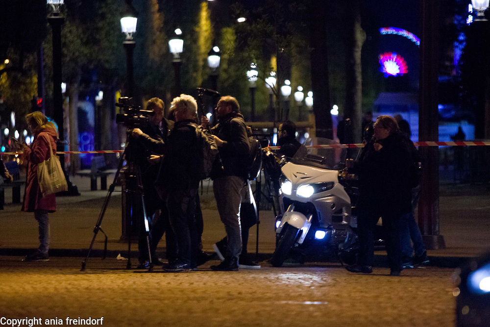 Terror Attack Champs Elysee, police officer and suspect shot dead on Champs Elysees in attack claimed by Islamic State, one tourist woman injured, another french police officer badly injured, Paris, France, journalists covering,