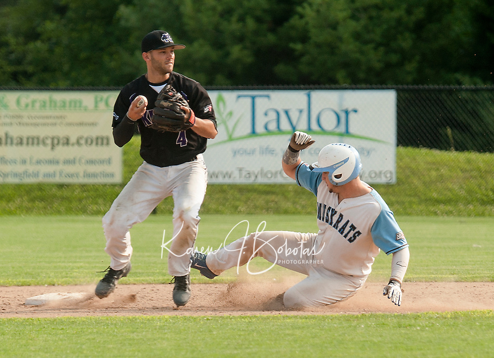 Jarred Mederos looks for the double play after getting the out on Jake Henson during Tuesday night's opening game of a double header with the Keene Swamp Bats.  (Karen Bobotas/for the Laconia Daily Sun)