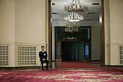 A Chinese attendant in the Great Hall of the People during a session of the National People's Congress, China's Parliament.
