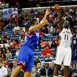Nov 16, 2013; New Orleans, LA, USA; New Orleans Pelicans point guard Jrue Holiday (11) shoots against the Philadelphia 76ers during the second half of a game at New Orleans Arena. The Pelicans defeated the 76ers 135-98. Mandatory Credit: Derick E. Hingle-USA TODAY Sports