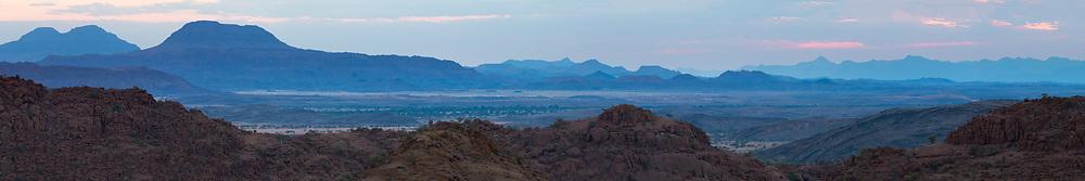 Twilight decends upon the landscape of Damaraland, Twyfelfontein, Namibia.
