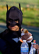 Middletown, New York  - A boy wearing a costume gets ready to eat a hot dog during the Halloween Fall Festival at the Middletown YMCA's Center for Youth Programs on Oct. 25, 2014.