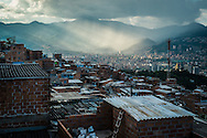 """2015/11/23 - Medellín, Colombia: View of the city of Medellín from the Pablo Escobar neighbourhood. Originally called """"Medellin Sin Tugurios,"""" or Medellin Without Shanty Towns, Barrio Pablo Escobar is located high up on the eastern slope of Medellin, where Pablo Escobar built 413 houses, which he gave to poor people that used to live in a mountain of garbage in the Moravia neighbourhood. (Eduardo Leal)"""