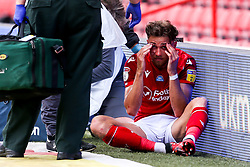 Matty Cash of Nottingham Forest looks dazed after getting a boot to the head - Mandatory by-line: Robbie Stephenson/JMP - 01/07/2020 - FOOTBALL - The City Ground - Nottingham, England - Nottingham Forest v Bristol City - Sky Bet Championship