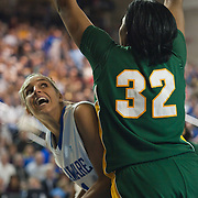 Delaware Forward Elena Delle Donne (11) attempts a shot under the basket while George Mason Forward Evelyn Lewis (32) defends in first half of an NCAA college basketball game against George Mason Thursday, Feb. 23, 2012, at the Bob Carpenter Center in Newark, Del. (AP Photo/Saquan Stimpson)