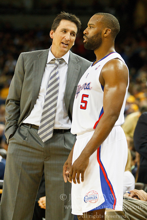 October 29, 2010; Oakland, CA, USA;  Los Angeles Clippers head coach Vinny Del Negro talks to point guard Baron Davis (5) during a timeout against the Golden State Warriors during the fourth quarter at Oracle Arena. The Warriors defeated the Clippers 109-91.