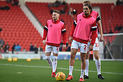 Alfie May of Doncaster Rovers (19) in the background, warming up with team mate Niall Mason of Doncaster Rovers (2) during the EFL Sky Bet League 1 match between Doncaster Rovers and AFC Wimbledon at the Keepmoat Stadium, Doncaster, England on 17 November 2018.