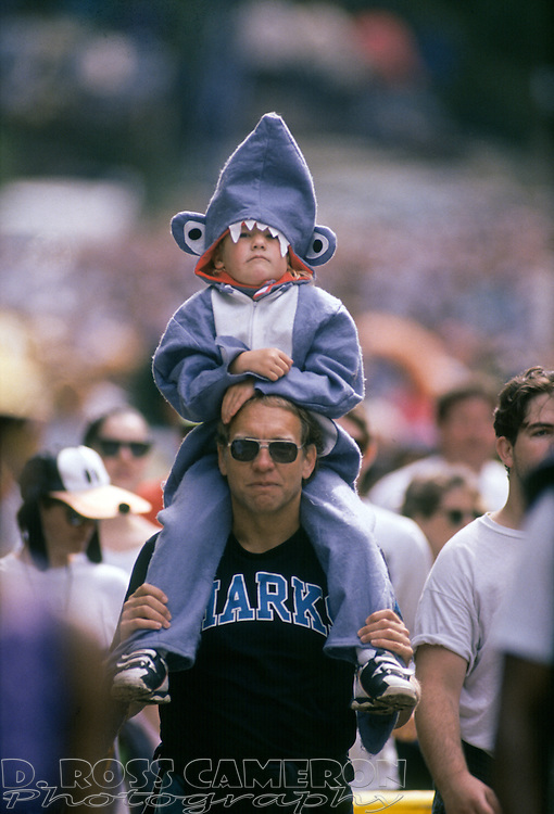 Unidentified father and son Sharks fans (one assumes of the NHL's San Jose variety), walk through Golden Gate Park at the 83rd running of the Bay to Breakers 12K race, Sunday, May 15, 1994 in San Francisco. (Photo by D. Ross Cameron)