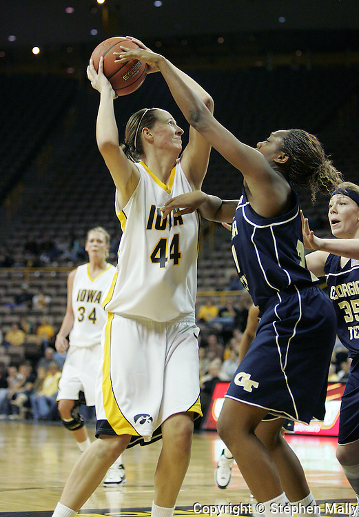 28 NOVEMBER 2007: Iowa center Megan Skouby (44) tries to put up a shot over Georgia Tech guard Iasia Hemingway (34) in the first half of Georgia Tech's 76-57 win over Iowa in the Big Ten/ACC Challenge at Carver-Hawkeye Arena in Iowa City, Iowa on November 28, 2007.