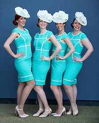 LIVERPOOL, ENGLAND - Thursday, April 9, 2015: The Jukebox Singers; Hilary, Natalie, Ada and Amy-Jean from London wearing bespoke hats and dresses from Dorothy Perkins, during Grand Opening Day on Day One of the Aintree Grand National Festival at Aintree Racecourse. (Pic by David Rawcliffe/Propaganda)