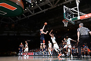 February 13, 2018: Jack Salt #33 of Virginia shoots over Ebuka Izundu #15 of Miami during the NCAA basketball game between the Miami Hurricanes and the Virginia Cavaliers in Coral Gables, Florida. The Cavaliers defeated the 'Canes 59-50.
