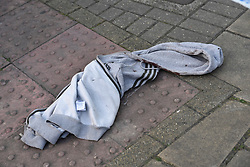 © Licensed to London News Pictures. 06/05/2018. LONDON, UK.  A blood strewn hoodie on the ground near Palmerston Road in Wealdstone, near Harrow, north west London, following reports of two separate shooting incident around midday on Sunday 6 May 2018.  The two victims are a 12 year old boy and a15 year old boy.  Investigations are ongoing.  Photo credit: Stephen Chung/LNP