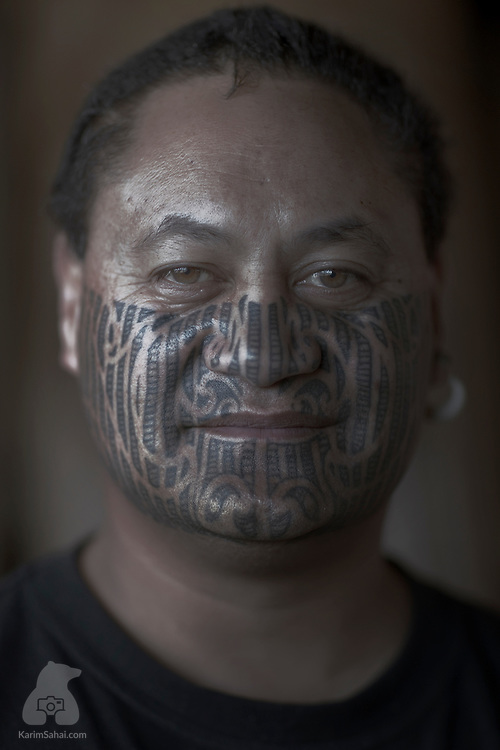 Maori man with a moko (facial tattoo), New Zealand.