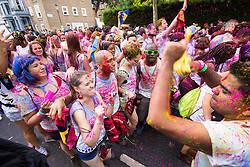 London, August 28th 2016. Revellers throw coloured powder and dance to loud soca music on Ladbroke Grove as Europe's biggest street party, the Notting Hill Carnival gets underway.