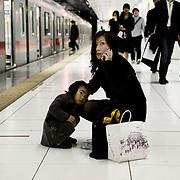 Yokohama, Japan, March, 2009. Mother & daughter in the subway.