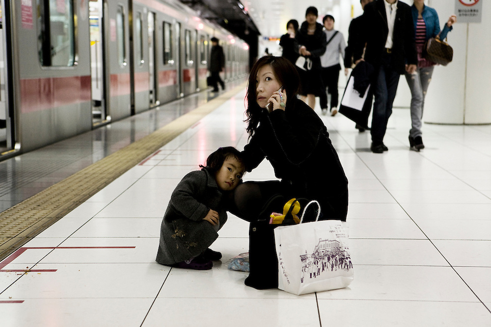 Yokohama, Japan, March, 2009. Mother & daughter in the subway.