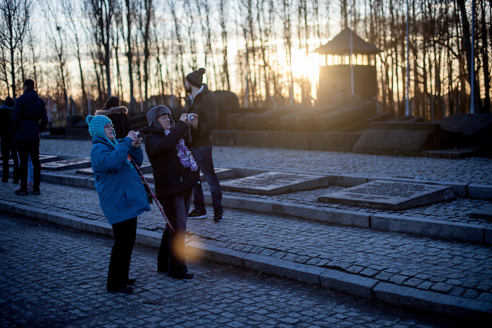 Visitors taking photographs at the Auschwitz Birkenau Nazi concentration camp. It is estimated that between 1.1 and 1.5 million Jews, Poles, Roma and others were killed in Auschwitz during the Holocaust in between 1940-1945.
