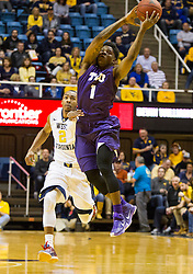Feb 13, 2016; Morgantown, WV, USA; TCU Horned Frogs guard Chauncey Collins (1) jumps for a ball on a fast break during while defended by West Virginia Mountaineers guard Jevon Carter (2) during the first half at the WVU Coliseum. Mandatory Credit: Ben Queen-USA TODAY Sports