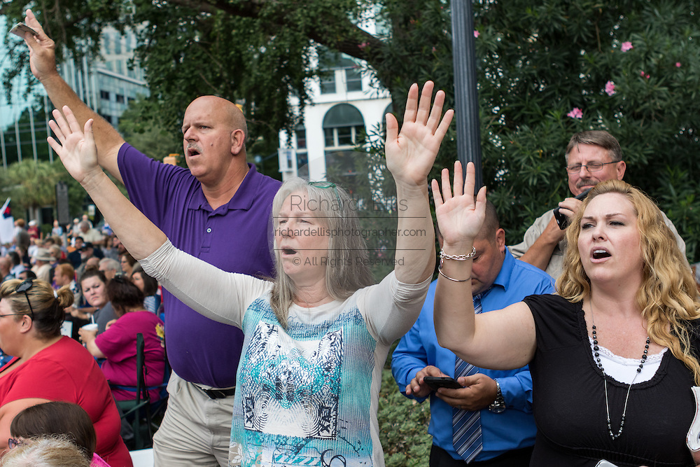 "Evangelical Christians pray during the ""Stand With God"" rally  August 29, 2015 in Columbia, SC. Thousands of conservative Christians gathered at the State House to rally against gay marriage and listen to GOP presidential candidates Gov. Rick Perry and Sen. Ted Cruz speak."