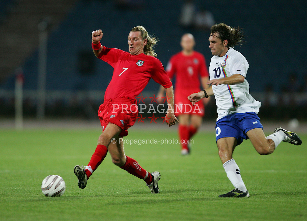 BAKU, AZERBAIJAN - SATURDAY SEPTEMBER 4th 2004: Wales' Robbie Savage is chased by Azerbaijan's Anatoli Ponomaryov during the opening Group Six World Cup Qualifyer at the Tofig Bahramov Republican Stadium in Baku. (Photo by David Rawcliffe/Propaganda)