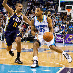 December 17, 2010; New Orleans, LA, USA; New Orleans Hornets shooting guard Willie Green (33) drives past Utah Jazz point guard Earl Watson (11) during the second half at the New Orleans Arena.  The Hornets defeated the Jazz 100-71. Mandatory Credit: Derick E. Hingle