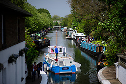 © Licensed to London News Pictures.30/04/2017.London, UK. Canalway Cavalcade festival takes place in Little Venice, London on Saturday, 30 April 2017. Inland Waterways Association's annual gathering of canal boats brings around 130 decorated boats together in Little Venice's canals on May bank holiday weekend. Photo credit: Ben Cawthra/LNP